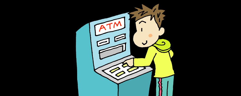 ATMで入金する男性